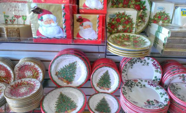 Christmas plates, napkins, and other table settings.
