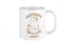 ceramic mug with groundhog day logo