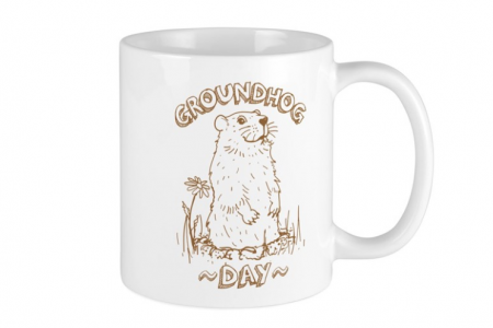 coffee mug with groundhog day logo on front